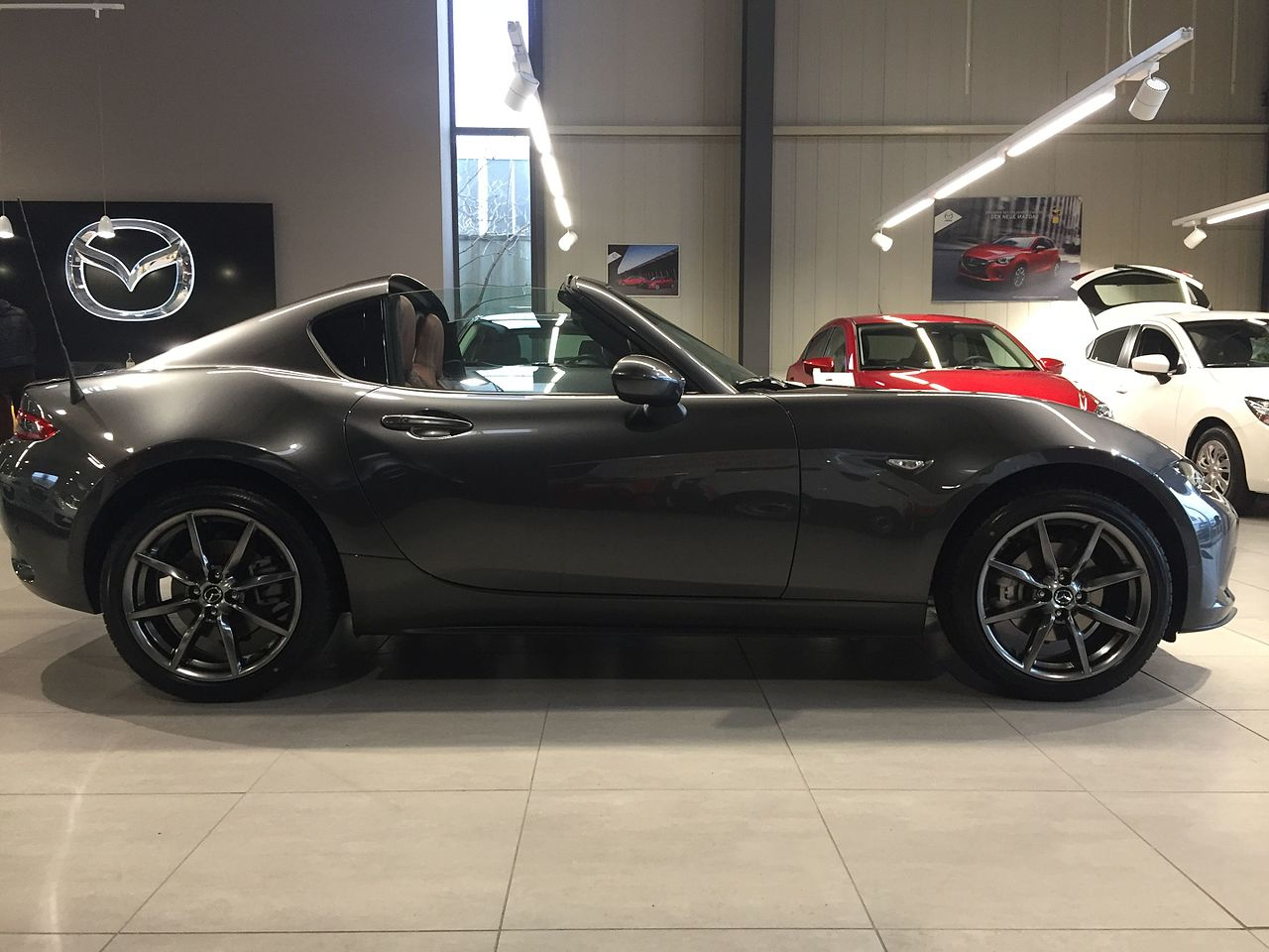 A Miata With A Folding Metal Roof