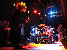 Melvins live in October 2006. Left to right: Buzz Osborne, Coady Willis, Dale Crover (behind drum kit) and Jared Warren.