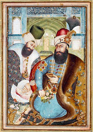 The founder of the Zand dynasty, Karim Khan (1750-1779), is portrayed as a powerful ruler, while the Ottoman ambassador who visited Shiraz in 1775 is suitably obsequious. The bearded ruler, who never adopted the title of king, is seated with a bouquet of flowers and his cup of wine, wearing a fur-trimmed caftan of Persian brocade and the kind of hat that was used under both the Afsharids and the Zand dynasty. The painting was later attributed correctly to Abu'l Hasan Mustawfi, an artist who had also served for many years as a provincial governor and was moreover a respected historian. The dating 1161 H (1749-1750), however, is incorrect. Abu'l Hasan's first known painting was actually from 1775, the year of the ambassador's visit.