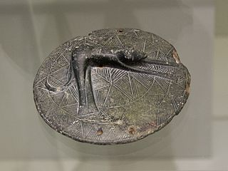 Stone pyxis lid with dog