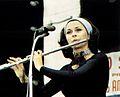 Miss America 1975 playing flute aboard USS John F. Kennedy (CV-67) 1975.jpg