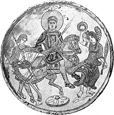 Missorium depicting Emperor Constantine the Great's son Constantius II accompanied by a guardsman with the Chi-Rho depicted on his shield (at left, behind the horse). Missorium Kerch.jpg