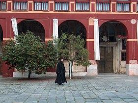 Monk walking in Vatopedi monastery court 2006.jpg