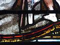 Montagnac-la-Crempse église vitrail au-dessus portail signature.JPG
