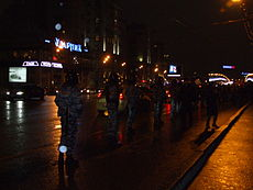 Police officers walking onto a road, observing protestors Image: Lvova Anastasiya.
