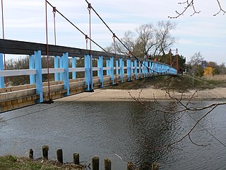 The pedestrian bridge over the river Sventoji at Sventoji resort