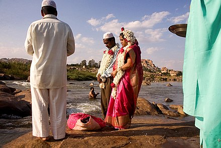A Muslim couple being wed alongside the Tungabhadra River at Hampi, India. Muslim wedding in India.jpg