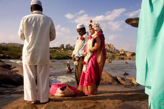 A Muslim couple being wed alongside the Tungab...