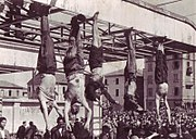 Benito Mussolini, Claretta Petacci and other Fascists hung by their feet after being executed.