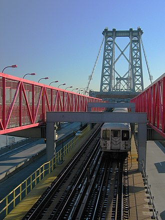 Elevated railway -  New York City Subway J train crosses the East River separating Brooklyn and Manhattan via the Williamsburg Bridge.