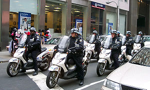 Organization of the New York City Police Department - NYPD officers patrol on scooters