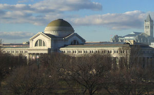 National Museum of Natural History - The museum as seen from the National Mall, the Old Post Office Building visible in the distance