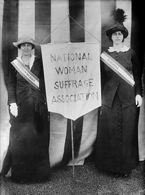 National Woman Suffrage Association - Suffragists Katharine McCormick and Mrs. Charles Parker, holding a historical NWSA banner on April 22, 1913
