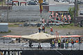 Naval Facilities Engineering Command personnel prepare to load a U.S. Navy X-47B Unmanned Combat Air System demonstrator aircraft onto the flight deck of the aircraft carrier USS George H.W. Bush (CVN 77) 130506-N-FU443-162.jpg