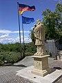 Nepomukstatue und Flaggen in Neuenburg am Rhein.jpg