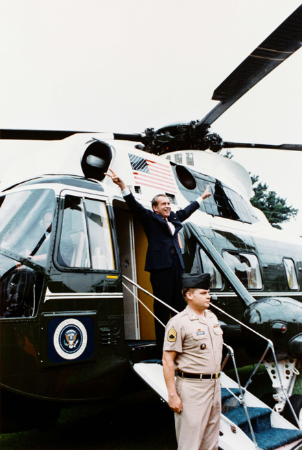 Nixon displays the V-for-victory sign as he departs the White House after resigning Nixon-depart.png