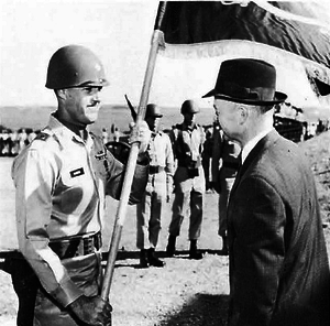 44th Air Defense Artillery Regiment - Lt. Col. Patrick W. Powers receives the 2nd/44th's colors from Dr. Finn J. Larsen during an organization ceremony at Ft. Sill, Oklahoma.