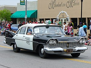 Old police car at the 2008 Rooster Days Parade.jpg