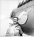 PO D Minchin beside his Kittyhawk aircraft.jpg