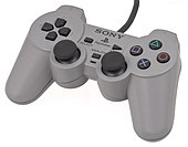 An original PlayStation Controller (top). This model was later replaced by the Dual Analog in 1997, and then the DualShock (bottom) that same year.