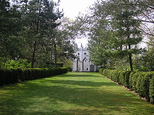 Painshill - The Gothic Temple is at the end of an avenue of pines and hedges.