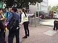 Peak Tram staff manage passengers queue up in 2015.jpg