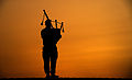 Piper with 4SCOTS Playing the Bagpipes at Sunset in Afghanistan MOD 45158080.jpg