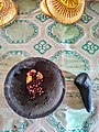 Plate and pestle from lava stone for grinding ingredients.jpg