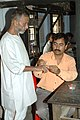 Poll personnel administering indelible ink to an old person in the first phase of Assam assembly election in Silchar, on April 3, 2006.jpg