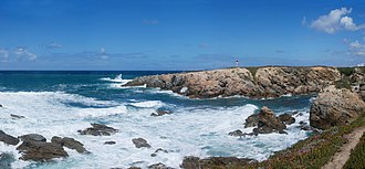 Coast - Atlantic rocky coastline, showing a surf area. Porto Covo, west coast of Portugal
