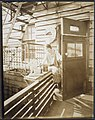 Portrait of an unidentified woman seated on a porch rail, ca. 1918-1920. (9564170174).jpg