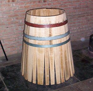"Cooper (profession) - Assembly of a barrel, called ""Mise en Rose"" in French."