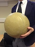 Pupil holding a harrow football.jpg