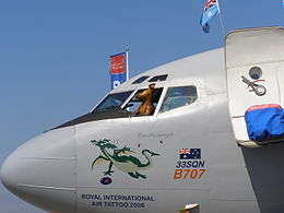 "Boeing 707 nose and cockpit with toy kangaroo at open window and cartoon of a dragon on the fuselage, along with the words ""33SQN B707"", ""Castlereagh"" and ""Royal International Air Tattoo 2006"""