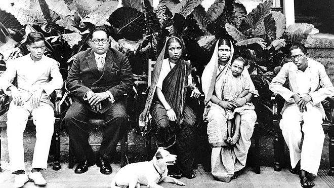 Ambedkar with his family members at Rajgruha in February 1934. From left - Yashwant (son), Ambedkar, Ramabai (wife), Laxmibai (wife of his elder brother, Balaram), Mukund (nephew) and Ambedkar's favourite dog, Tobby Rajagriha, Bombay, February 1934. (L to R) Yashwant, BR Ambedkar, Ramabai, Laxmibai, Mukundrao, and Tobby.jpg