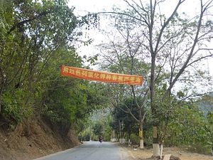 "Potassium chloride - ""Raise banana yields using potassium chloride!"", an ad above a highway in a banana-growing district of Hekou County, Yunnan, China"