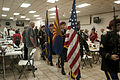 Retired and active duty veterans stand as the colors are retired during a Pearl Harbor Remembrance Day at the American Legion Post 19's Main Hall in Yuma, Ariz 121207-M-UQ043-003.jpg