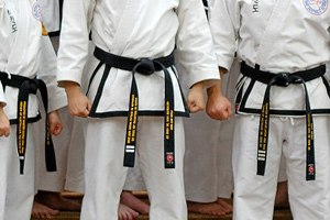 Black belt (martial arts) - Some martial art schools use embroidered bars to denote different levels of black belt rank, as shown on these taekwondo 1st, 2nd, and 3rd dan black belts.