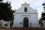 The lovely old Rhenish Mission Church with its fine gables, built in the form of an incomplete T, faces the southern side of the Braak. This is one of the oldest mission churches in South Africa. The delicate architectural treatment which betrays strong Renaissance influence, is typical of early 19th-century architecture. The gable, which bears the date of its erection, 1823, is one of the finest of its kind. In 1840 the northern wing was built.