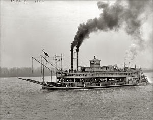 Louisiana State Penitentiary - Riverboat America with convicts and supplies, on the Mississippi River headed for Angola, circa late 1800s.