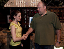 Gandolfini with actress Rose McGowan shaking hands