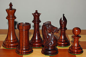 English: Rosewood chess pieces, from the Dalbe...