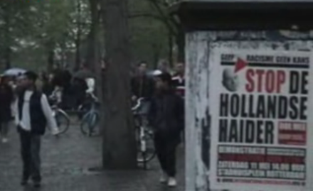 "Anti-Fortuyn poster of the International Socialists with the slogan ""Stop de Hollandse Haider"" (English: ""Stop the Dutch Haider"") near Fortuyn's house in Rotterdam on 6 May 2002 RotterdamGWBurgerPlein060502.png"