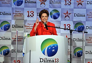 First inauguration of Dilma Rousseff - Rousseff campaigning under the continuity symbol at the Workers' Party National Convention.