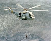 SH-3H HS-15 lowers AQS-13 sonar 1979.JPEG
