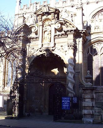 University Church of St Mary the Virgin - South porch, designed by Nicholas Stone, viewed from the High Street. Bullet holes in the statue were made by Oliver Cromwell's troops.