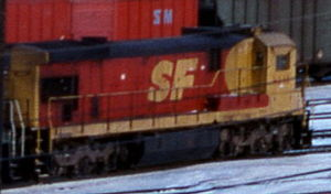 "Santa Fe–Southern Pacific merger - A Santa Fe locomotive painted in the ""Kodachrome"" merger paint."