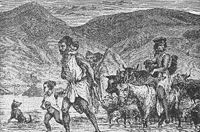 A Berber family crossing a ford - scene in Algeria. Berbers are the indigenous peoples of North Africa west of the Nile Valley.