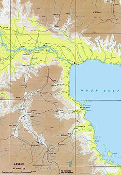 Topographic map of north east New Guinea, showing the Huon gulf on the right, the Markham River running across the top, and the Wau-Bulolo Valley on left.
