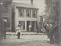 Samuel Clemens (Mark Twain) in doorway of his Hannibal, Missouri home, May 12, 1902.jpg